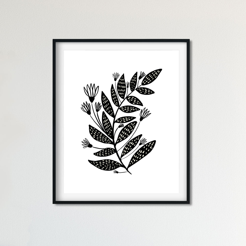 Floral black and white art wall in frame