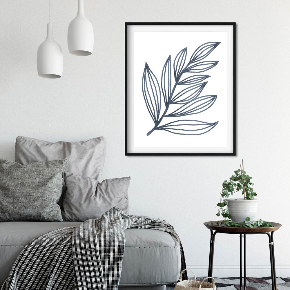 Blue leaf wall art in frame